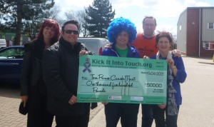 Donating a nice cheque to The Tom Prince Cancer Trust.